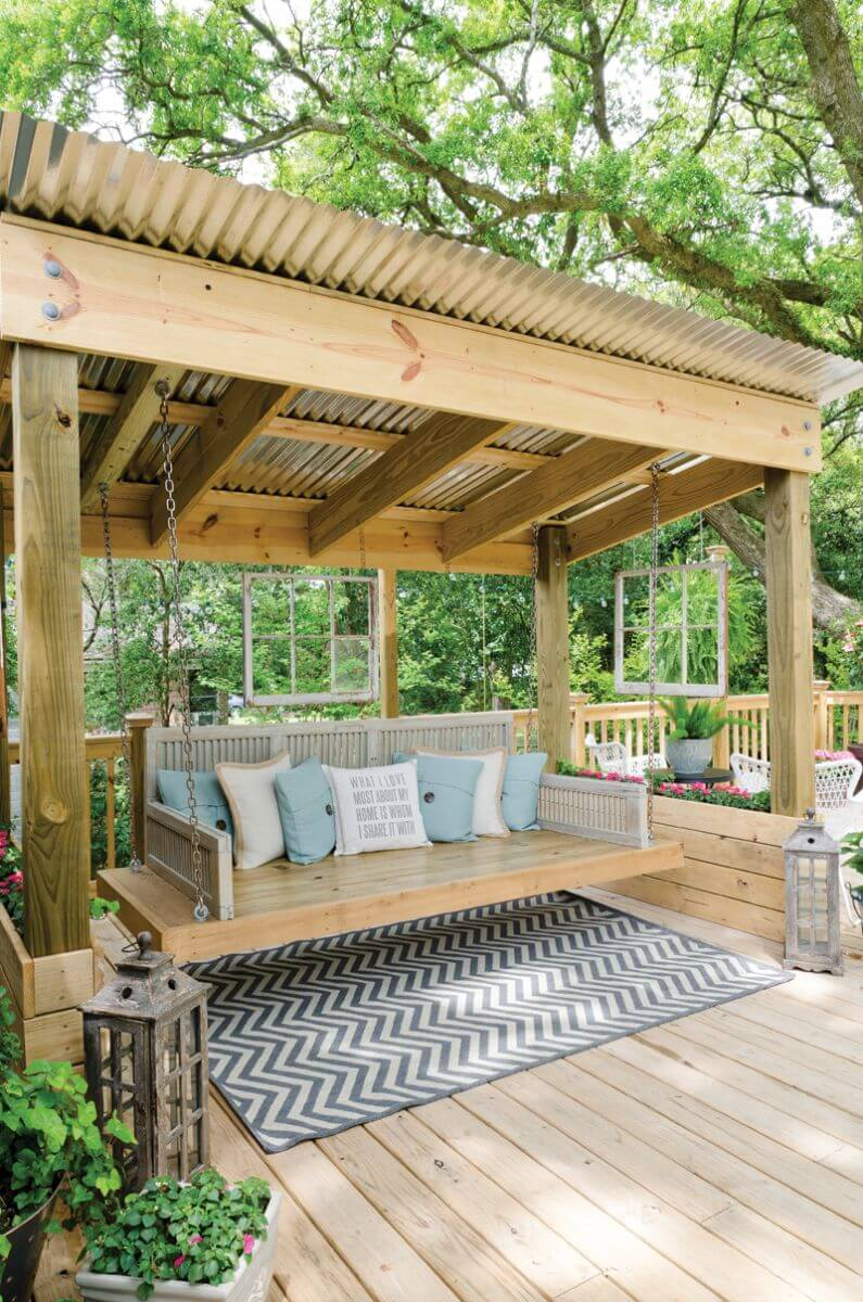 Shaded Gazebo and Lifted Polished Bench With Cushions