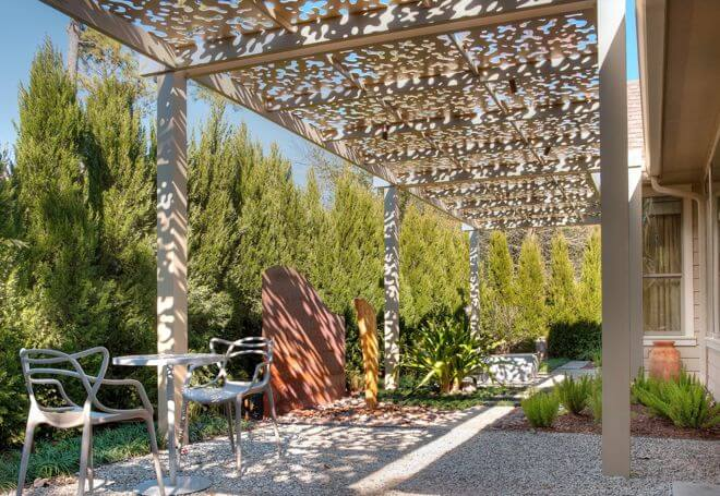 This modern pergola connects the patio to the home while providing wonderful dappled shade.