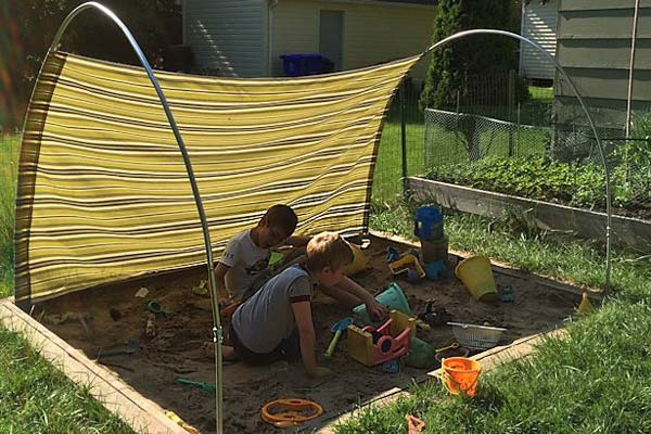Clever use of tubes for creating shade over lawn that moves with sun