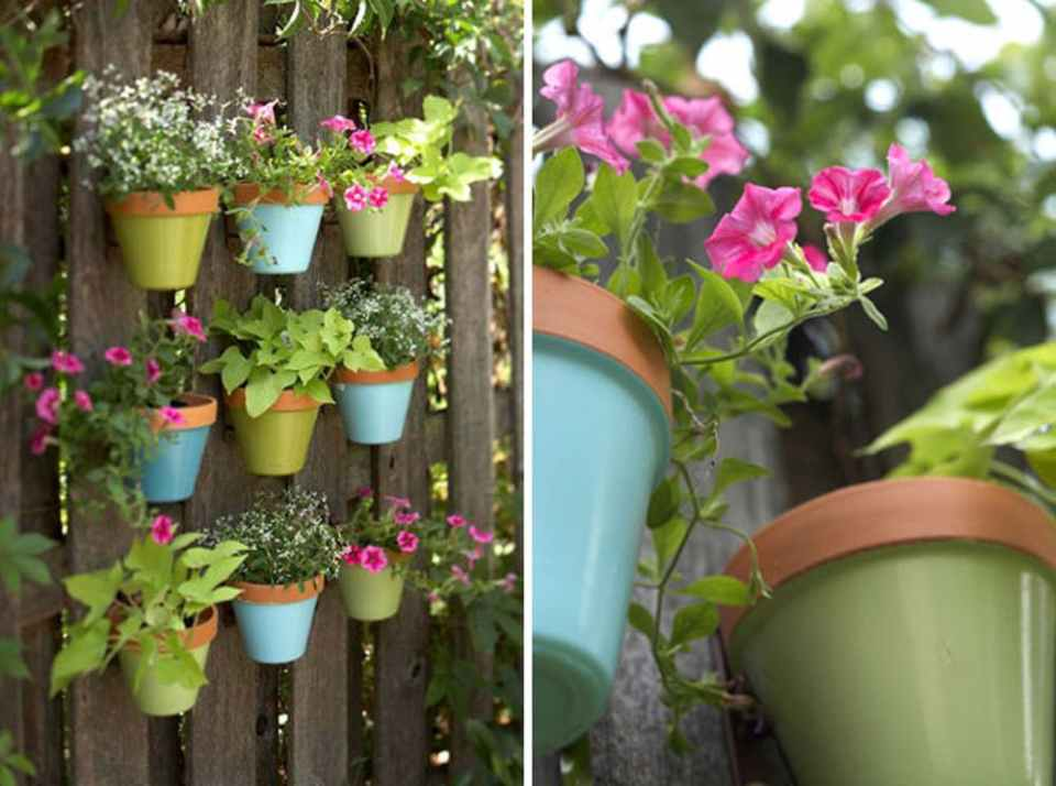 Painted Pots Hanging on Fence