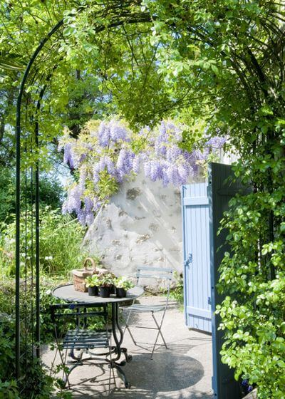 An idyllic French patio with fragrant wisteria and old stone walls — it's as if the bistro table and chairs were made for this spot. This outdoor furniture set is compact and portable and can fit on the smallest of patios. And of course it brings that French country magic along with it.