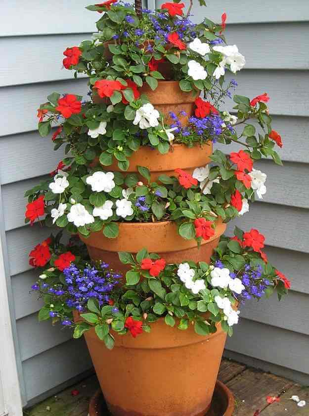 Tower Of Potted Red, White, And Blue