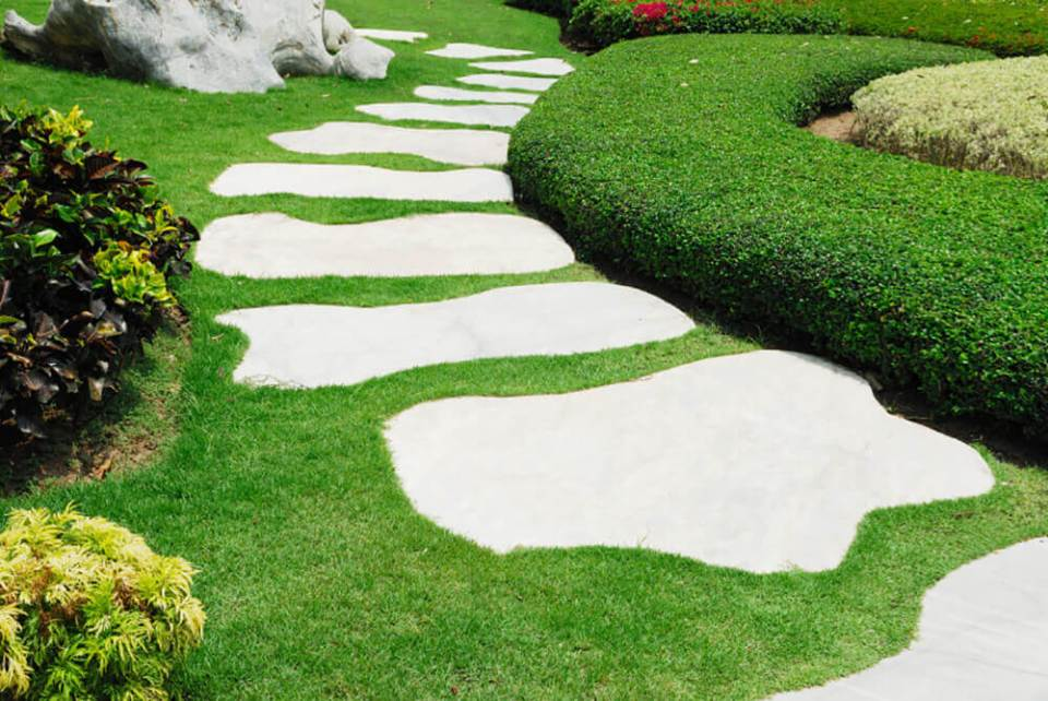 Walkway has marble slabs in whimsical shapes