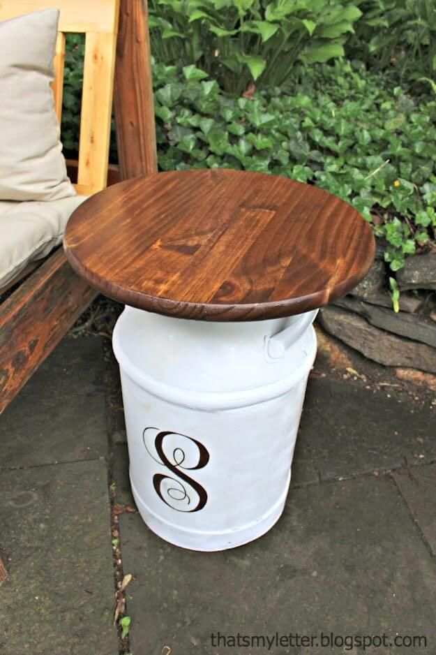 Initialed Milk Jug Serves as Side Table | DIY Painted Garden Decoration Ideas