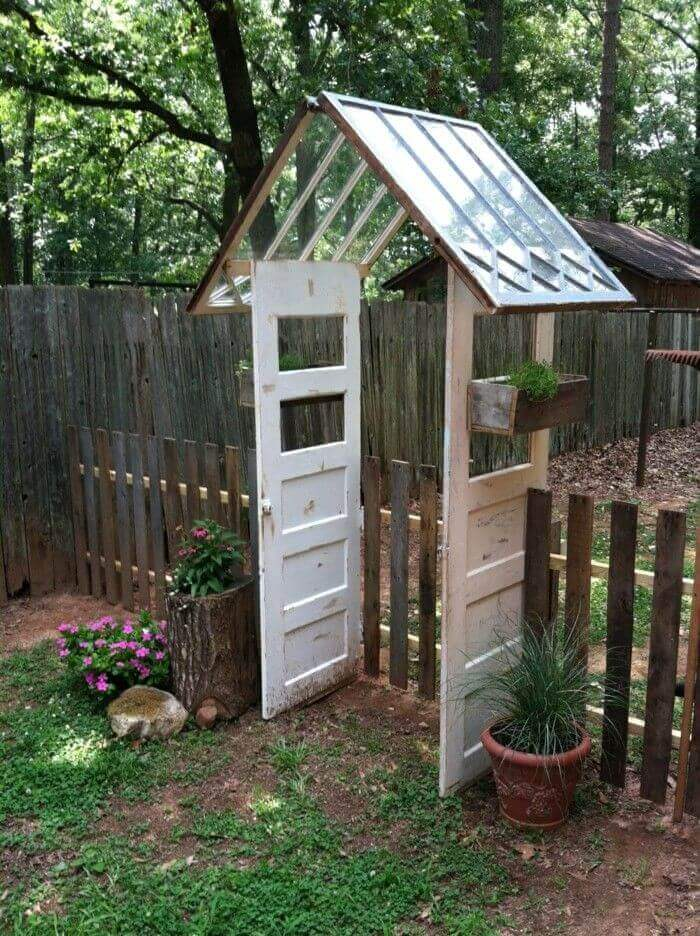 Reused Windows and Doors make a Gate | Creative Repurposed Old Door Ideas & Projects For Your Backyard