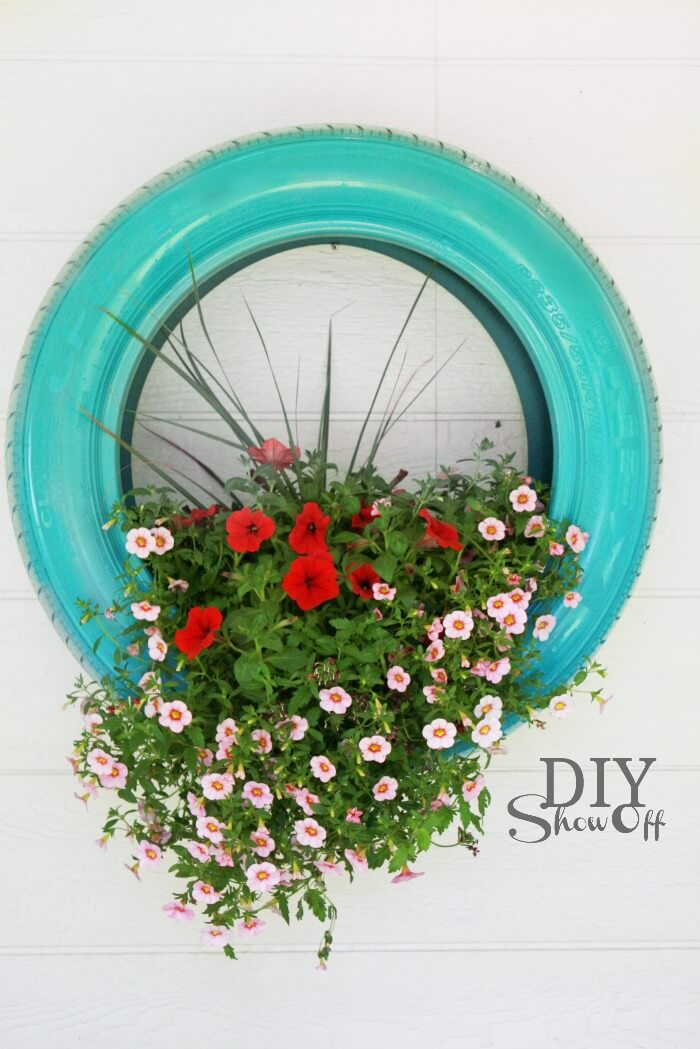 Tire Planter Colored in Teal Blue   DIY Painted Garden Decoration Ideas