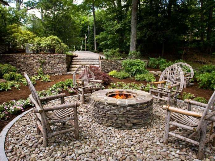 Wooden Seats Around a Stone Firepit | Awesome Firepit Area Ideas For Your Outdoor Activities