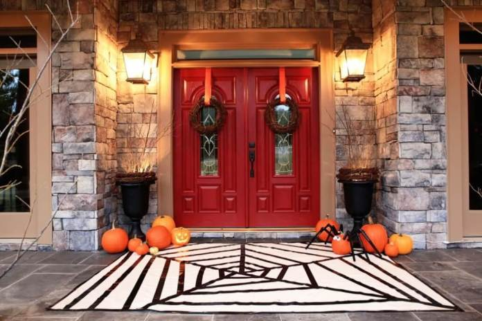 A Themed Welcome | Scary DIY Halloween Porch Decoration Ideas | vintage halloween porch