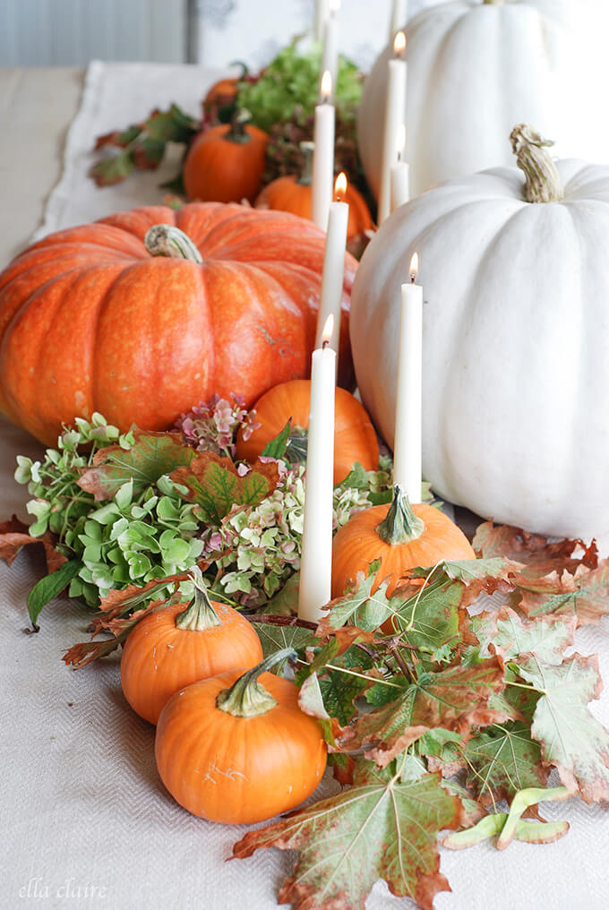 White Candles amongst Pumpkins | Best DIY Fall Centerpiece Ideas | FarmFoodFamily.com