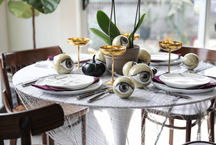 Wicked and eclectic Halloween table setting | Fun & Spooky Halloween Table Decoration Ideas - FarmFoodFamily.com