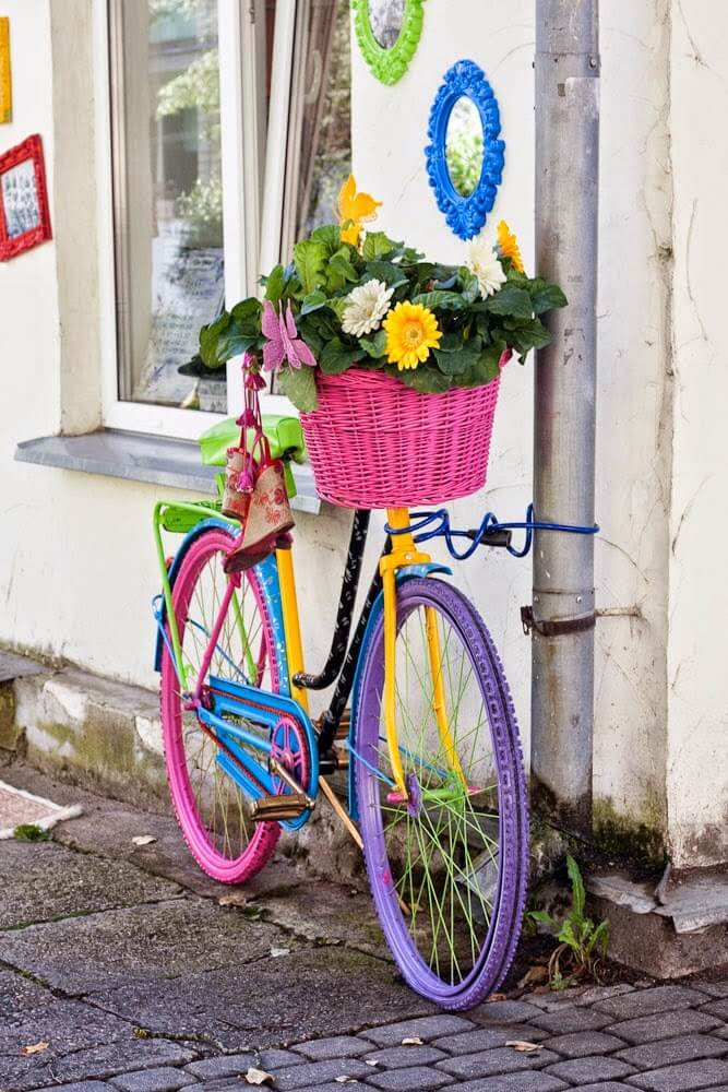 Rainbow bicycle | Bicycle Garden Planter Ideas For Backyards | FarmFoodFamily