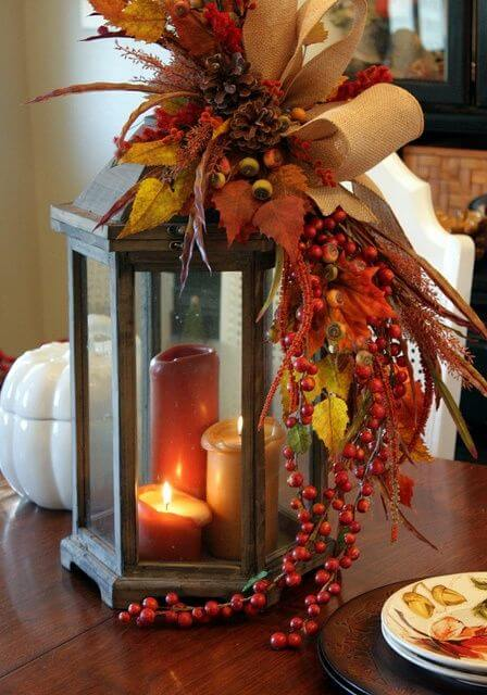 Fall themed centerpiece with candles and leaves | DIY Fall Candle Decoration Ideas - Farmfoodfamily.com
