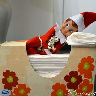 Elf makes himself a bed with the tissue box | Fun & Simple Elf on Shelf Ideas For This Christmas