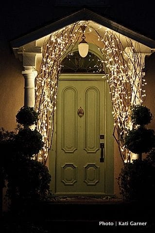 tall twigs with tangle of tiny lights | Christmas Door and Window Lighting Decorating Ideas