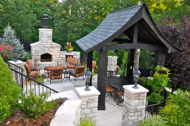 Backyard Pavilion ideas with stone fireplace