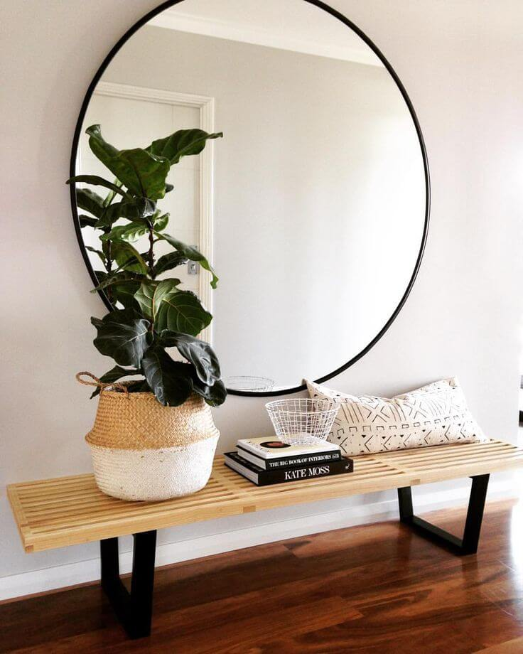 Large round mirror above a bench | Best Entryway Mirror Decor Ideas