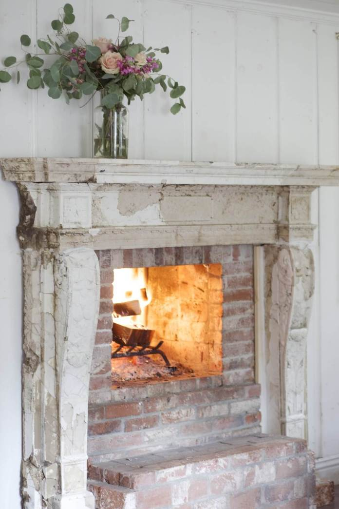 Antique fireplace with flowers