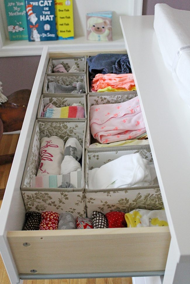 The organizer of baby clothes in the drawers
