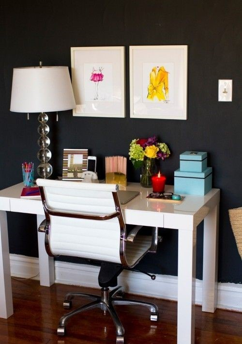 Painting a wall of black will make your furniture contrast