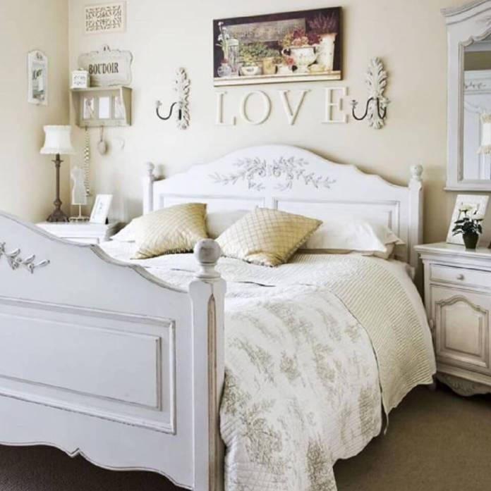 White bed and wooden love letters