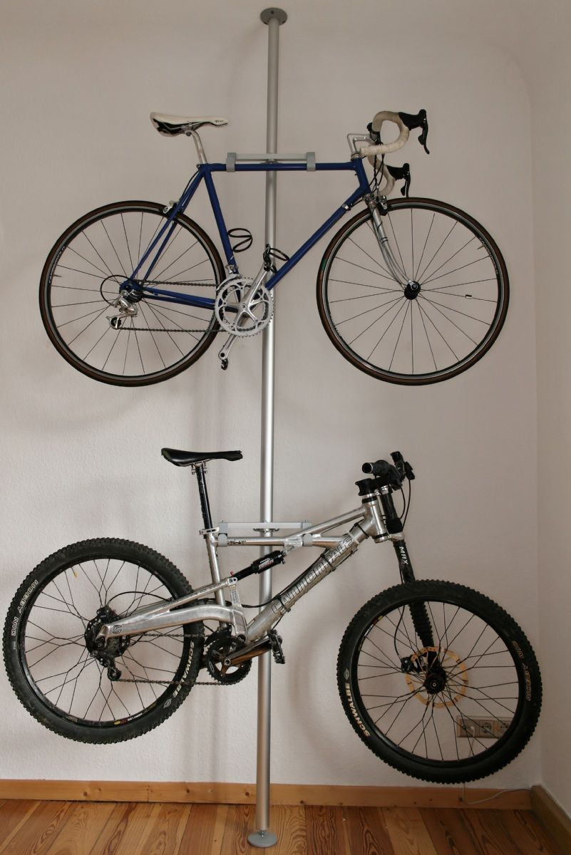 Tube with two hooks that serve as bicycle support