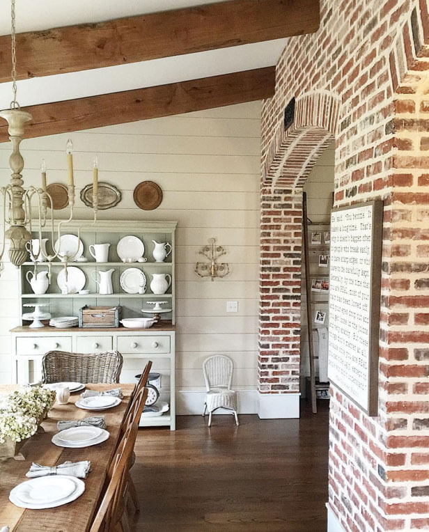 Reclaimed brick walls with barn beams and light fixtures