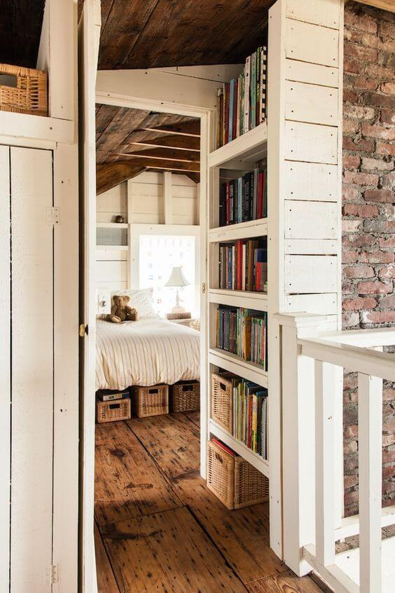 A large built-in bookcase with exposed brick walls