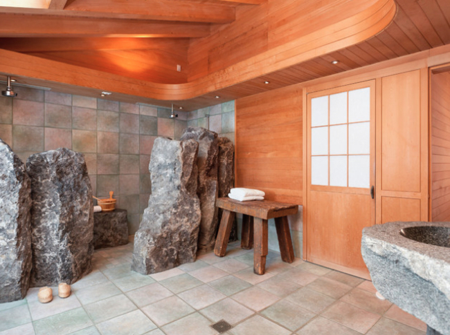 bathroom with stone designs and wooden walls
