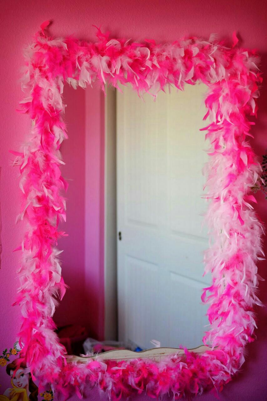 Mirror with frame of pink feathers