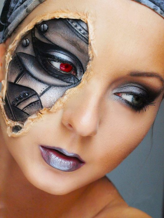 Girl with makeup for halloween with a piece of the face as a robot