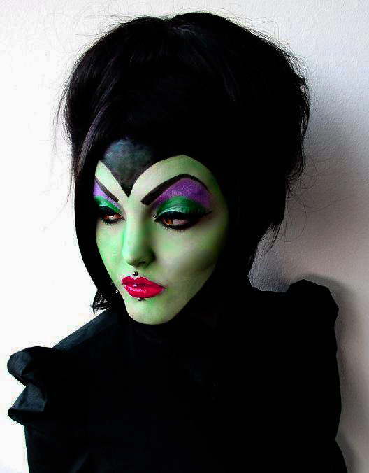 Girl with makeup for halloween as maleficent