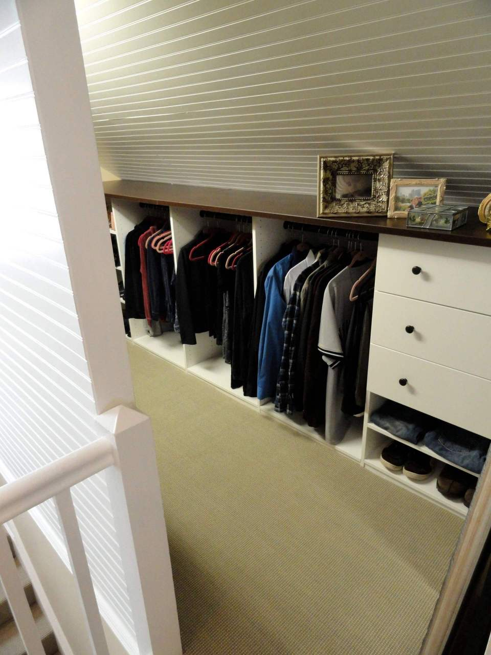 A closet with drawer on the lower end of the attic