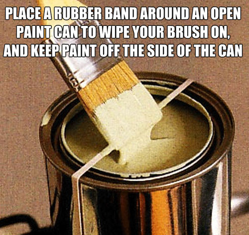 Rubber band on an open paint can wipe brush