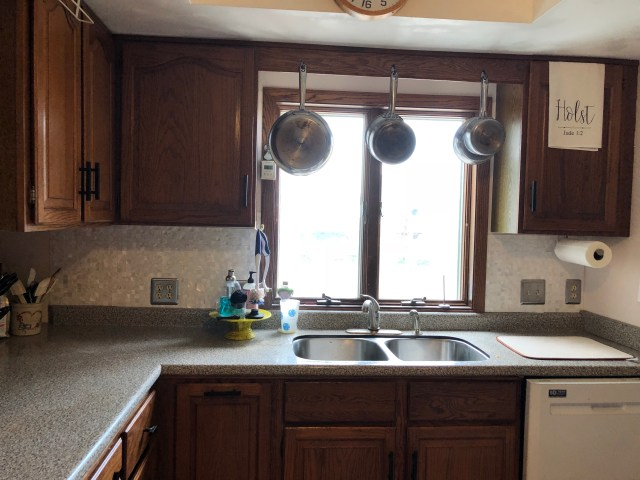 kitchen sink back splash window silver outlet covers hanging pans