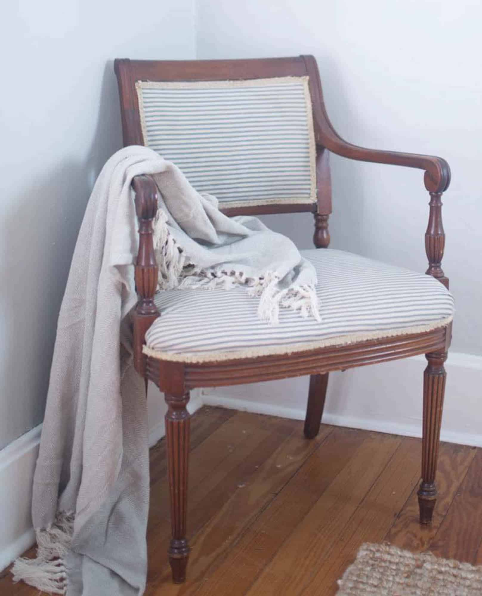 Learn how to reupholster a chair with a staple gun and hot glue. No sewing required.