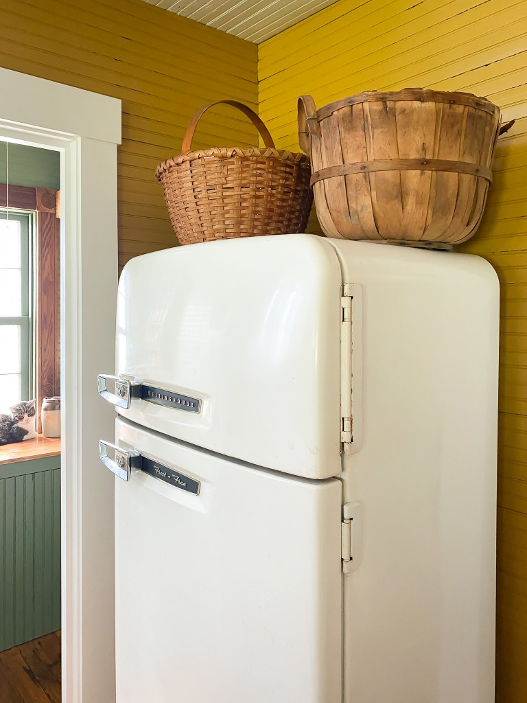 antique refrigerator with baskets