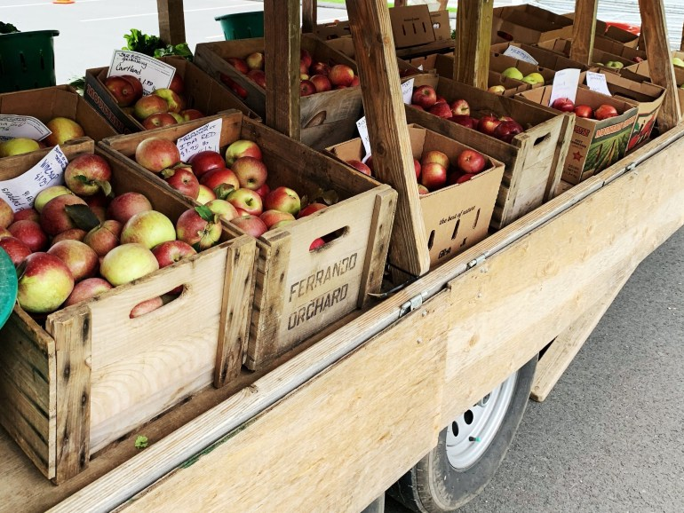 Apples in a farm stand truck