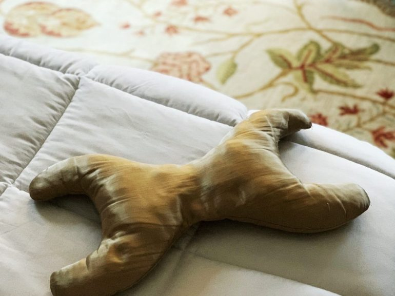 x shaped satin pillow to keep wrinkles at bay