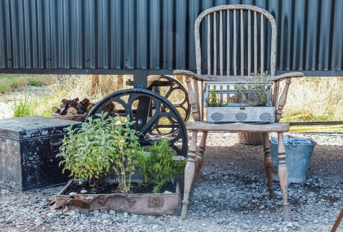 Quirky herb garden made in old suit cases