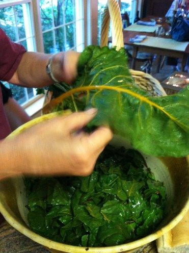 Tear greens from stalk