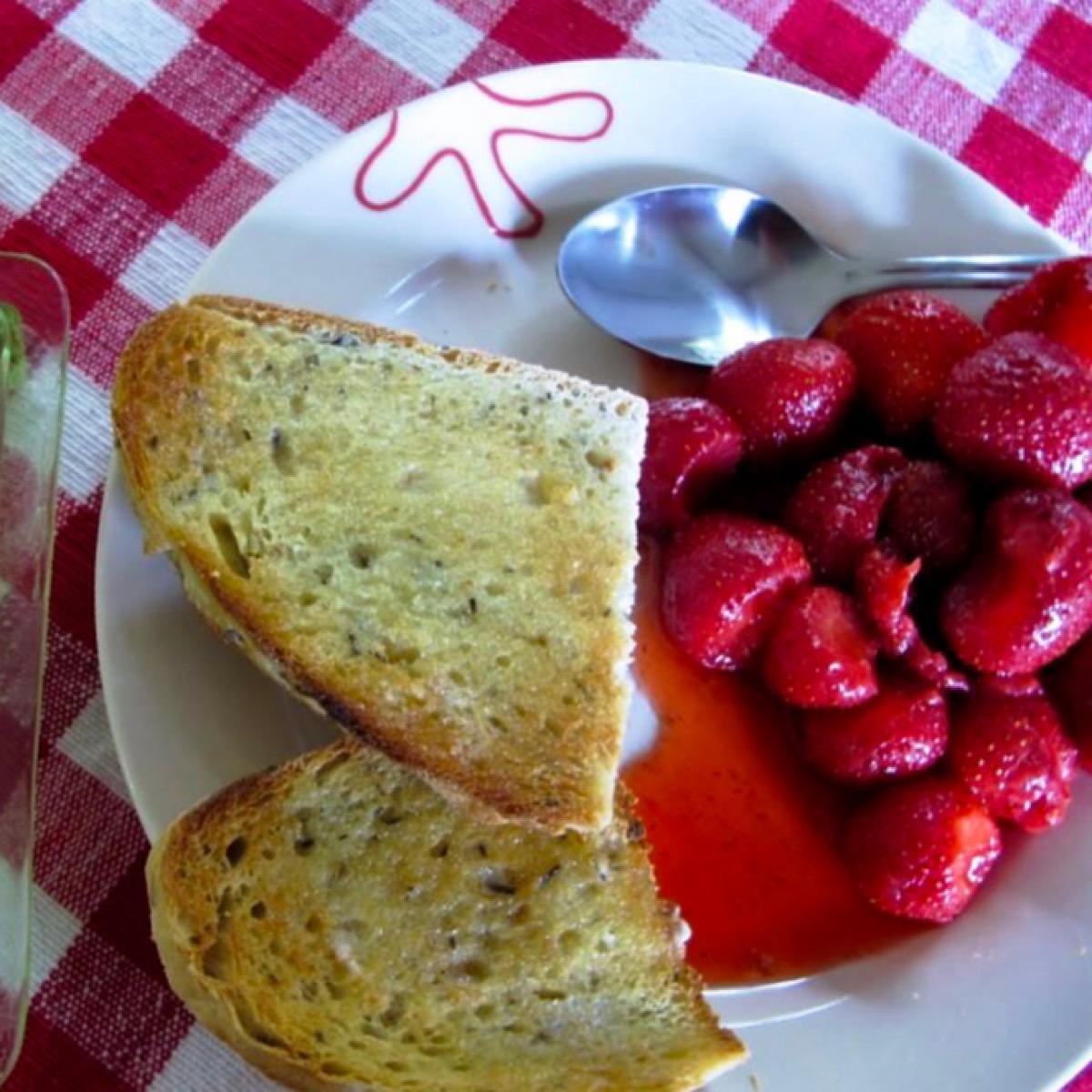 Fresh strawberries with balsamic vinegar sauce on breakfast plate