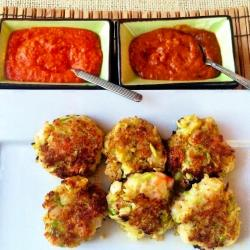 Low carb zucchini and shrimp fritters with sides of Romesco and Harissa sauces