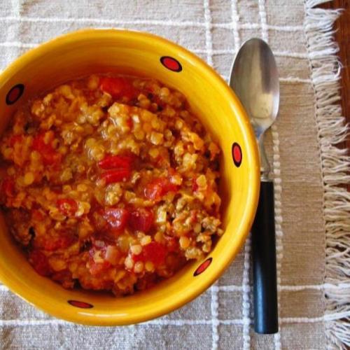 Bowl of lentil, tomato and chorizo mulligan