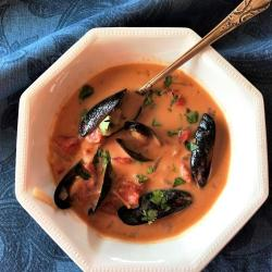 Low carb mussel and coconut curry stew in a single serving bowl