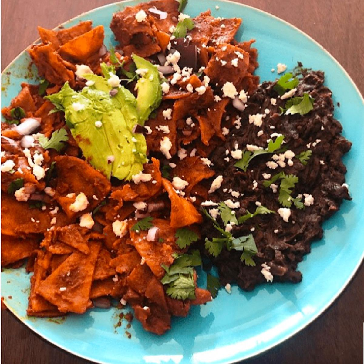 Chilaquiles with refried black beans