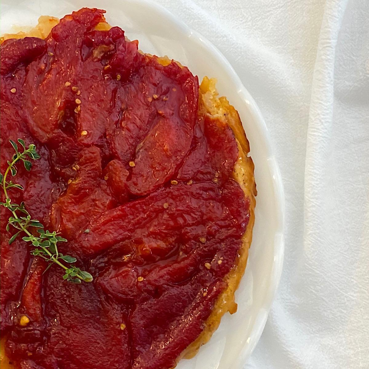 Caramelized Tomato Tarte Tatin with sprig of lemon thyme