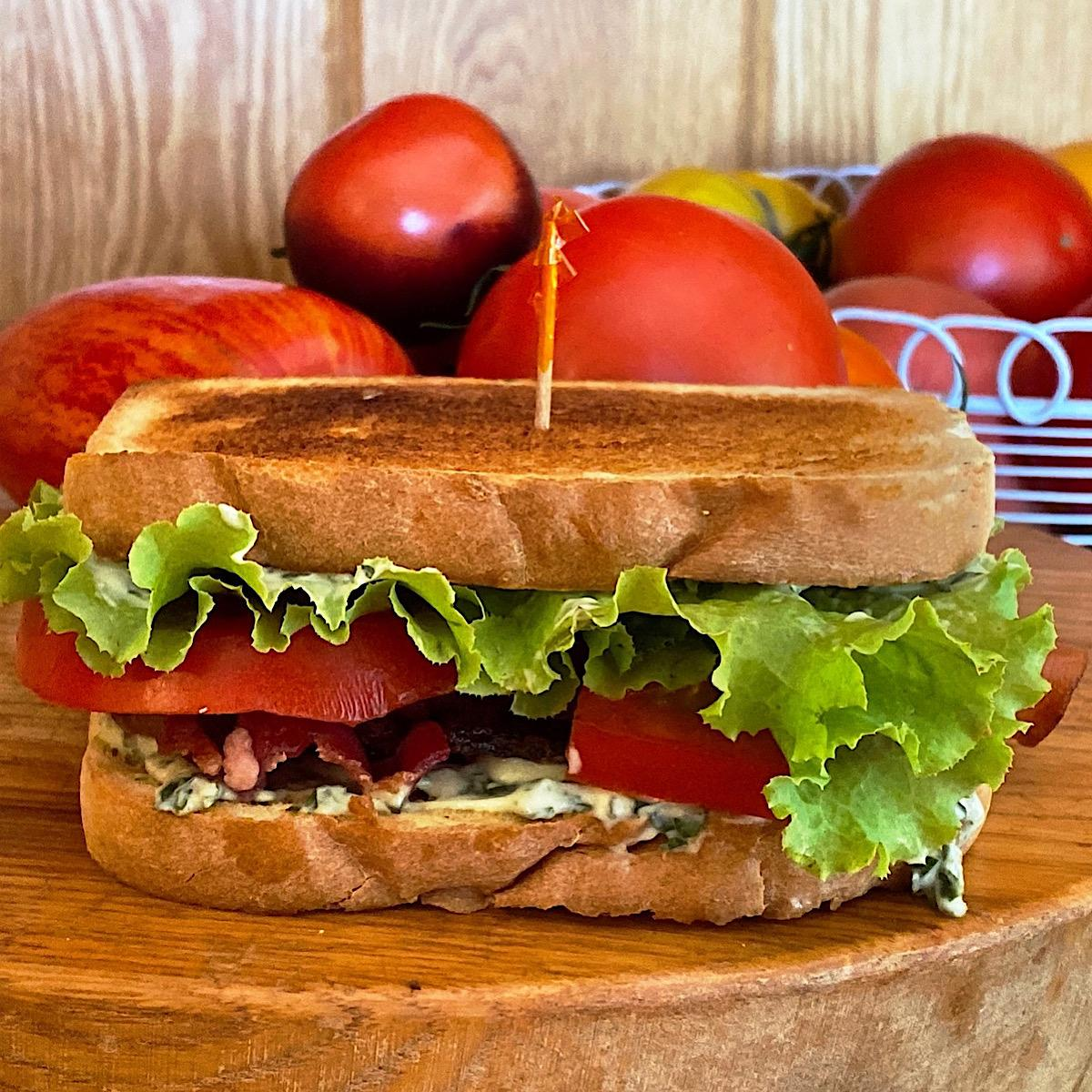 Classic BLT sandwich with basil mayonnaise and heirloom tomatoes