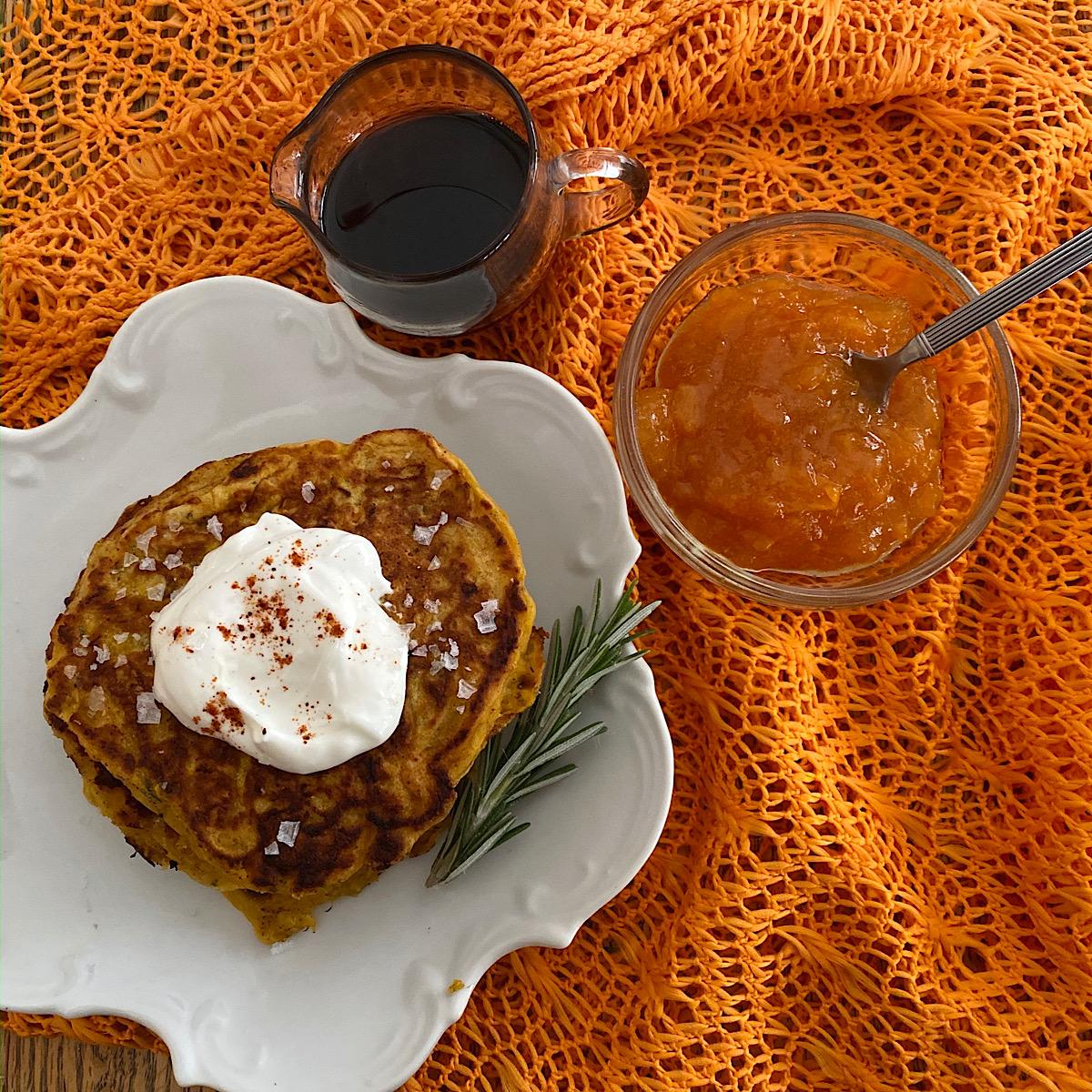 Pumpkin pancakes with side of apricot jam and maple syrup