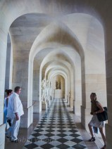 Long hallways, lovely light and matching tourists.