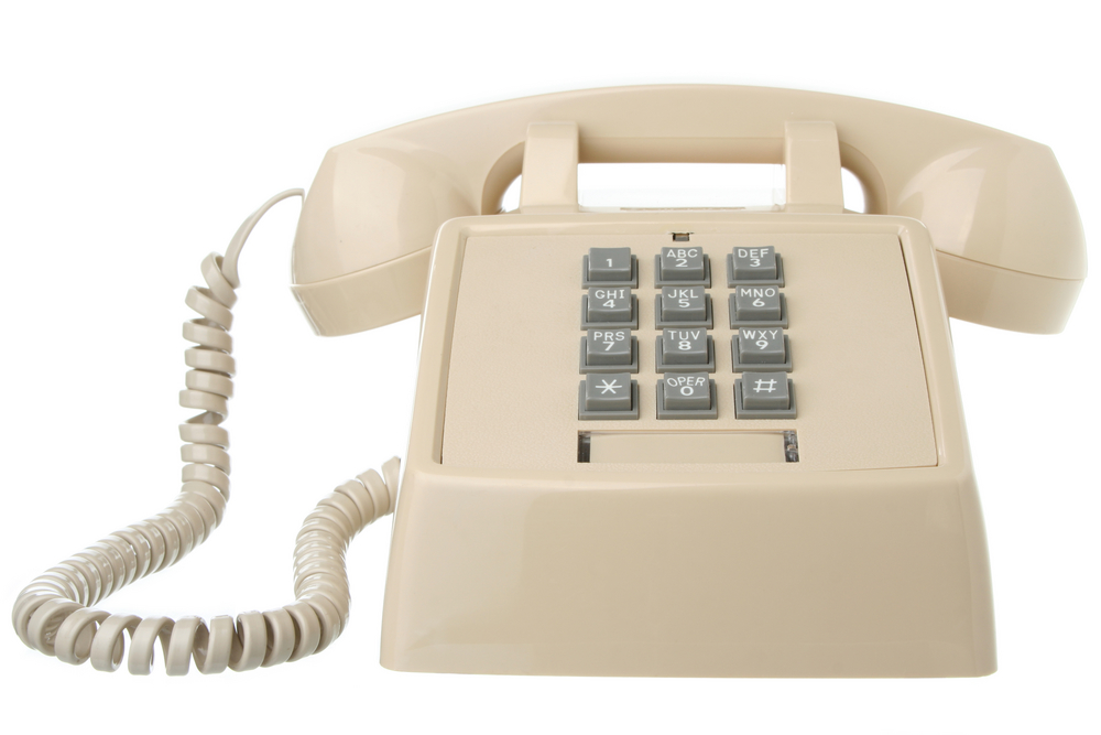 Vintage beige touch tone telephone isolated on white